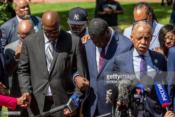 Members of the George Floyd family George Floyd's brothers Philonise and Terrence , nephew Brandon Williams , Reverend Al Sharpton pray following the...