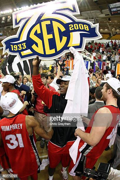 Members of the Georgia Bulldogs celebrate after defeating the Arkansas Razorbacks 6657 during the championship game of the SEC Men's Basketball...