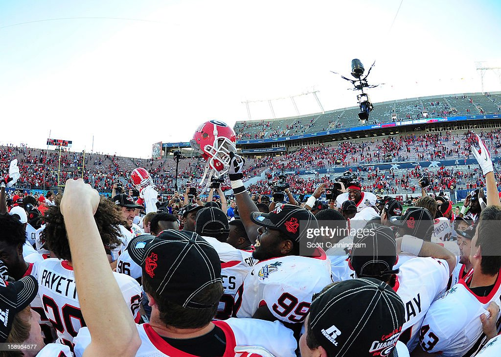 Members of the Georgia Bulldogs celebrate after the Capital One Bowl against the Nebraska Cornhuskers at the Citrus Bowl on January 1, 2013 in Orlando, Florida.