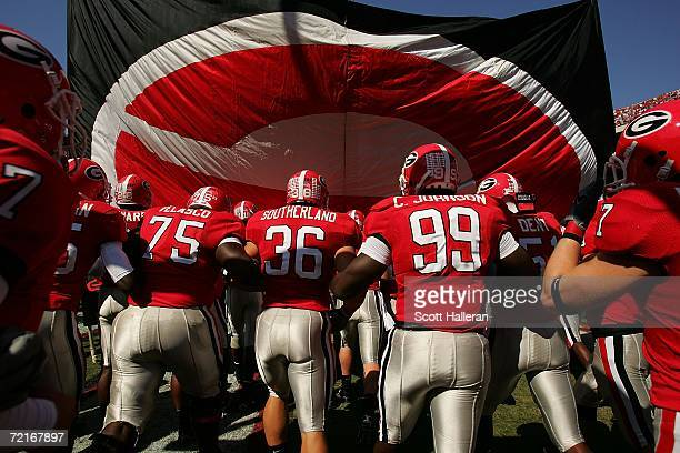 Members of the Georgia Bulldogs take the field against the Vanderbilt Commodores during their game at Sanford Stadium on October 14, 2006 in Athens,...