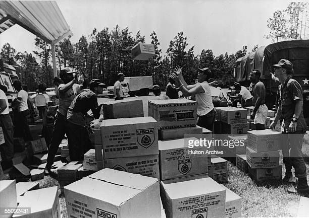 Members of the Georgia National Guard unload food donated by the US Department of Agriculture for distribution to those affected by Hurricane...