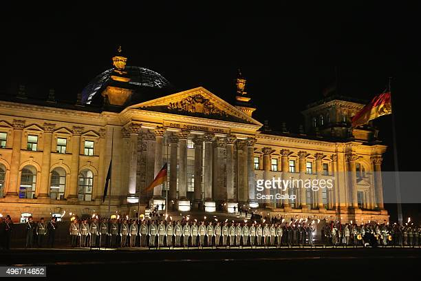Members of the German armed forces the Bundeswehr bearing torches attend a ceremony in front of the Reichstag to mark the 60th anniversary of the...