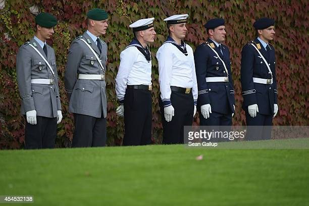 Members of the German armed forces, the Bundeswehr, stand at the periphery before the arrival of Myanmar President Thein Sein in the main courtyard...