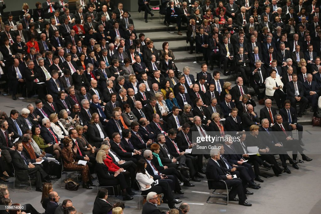 Members of the German Bundestag and French Assemble Nationale, including German Chancellor Angela Merkel and French President Francois Hollande, as well as German President Joachim Gauck and French Prime Minister Jean-marc Ayrault (all in the front row), attend a joint session of the two governments at the Bundestag during the 50th anniversary celebration of the Elysee Treaty on January 22, 2013 in Berlin, Germany. The treaty, concluded in 1963 by Charles de Gaulle and Konrad Adenauer in the Elysee Palace in Paris, set a new tone of reconciliation between France and Germany, and called for consultations between the two countries to come to a common stance on policies affecting the most important partners in Europe as well as the rest of the region. Since its establishment, the document for improved bilateral relations has been seen by many as the driving force behind European integration.
