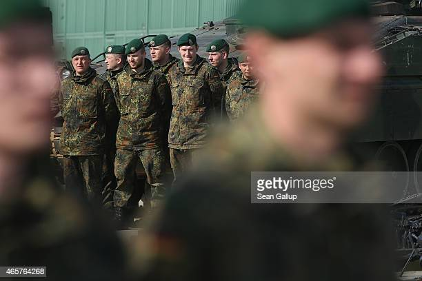 Members of the German Bundeswehr's 371st Armoured Infantry Battalion stand at attention prior to the arrival of a general during a media event at the...