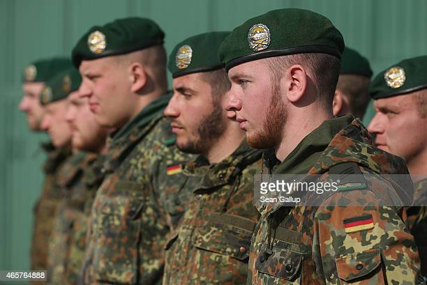 Members of the German Bundeswehr's 371st Armoured Infantry Battalion stand at attention during a media event at the battalion's base on March 10 2015...