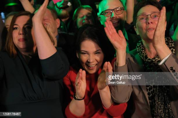 Members of the German Greens party, including co-leader Annalena Baerbock and local candidate Katharina Fegebank, react to initial exit polls that...