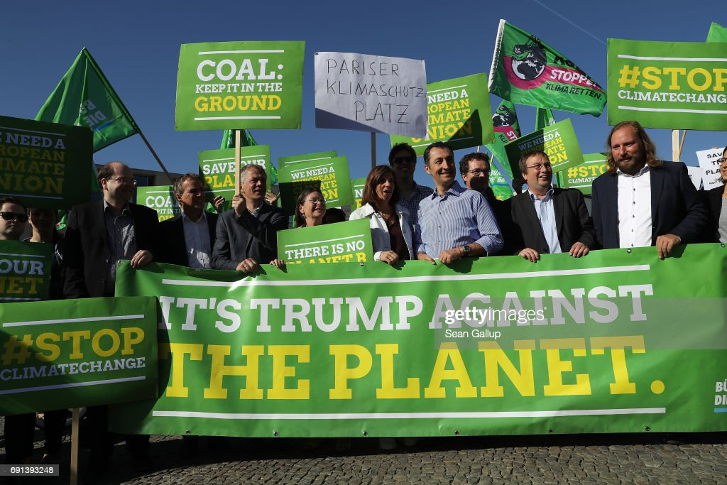Members of the German Greens Party (Buendnis 90/Die Gruenen), including party co-heads Katrin Goering-Eckardt and Cem Oezdemir (C), protest outside the U.S. Embassy against the announcement by U.S. President Donald Trump the day before that he will pull the USA out of the Paris Agreement on June 2, 2017 in Berlin, Germany. Politicians and governments across Europe have reacted with dismay and frustration over Trump's decision to pull the world's second biggest emitter of greenhouse gases out of the Paris Agreement. Nearly all the world's acountries signed the agreement in 2015 with the goal of setting a limit to global warming in an effort to counter climate change.