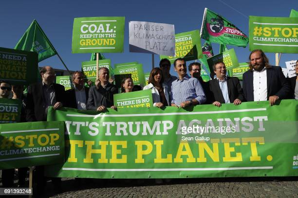 Members of the German Greens Party including party coheads Katrin GoeringEckardt and Cem Oezdemir protest outside the US Embassy against the...
