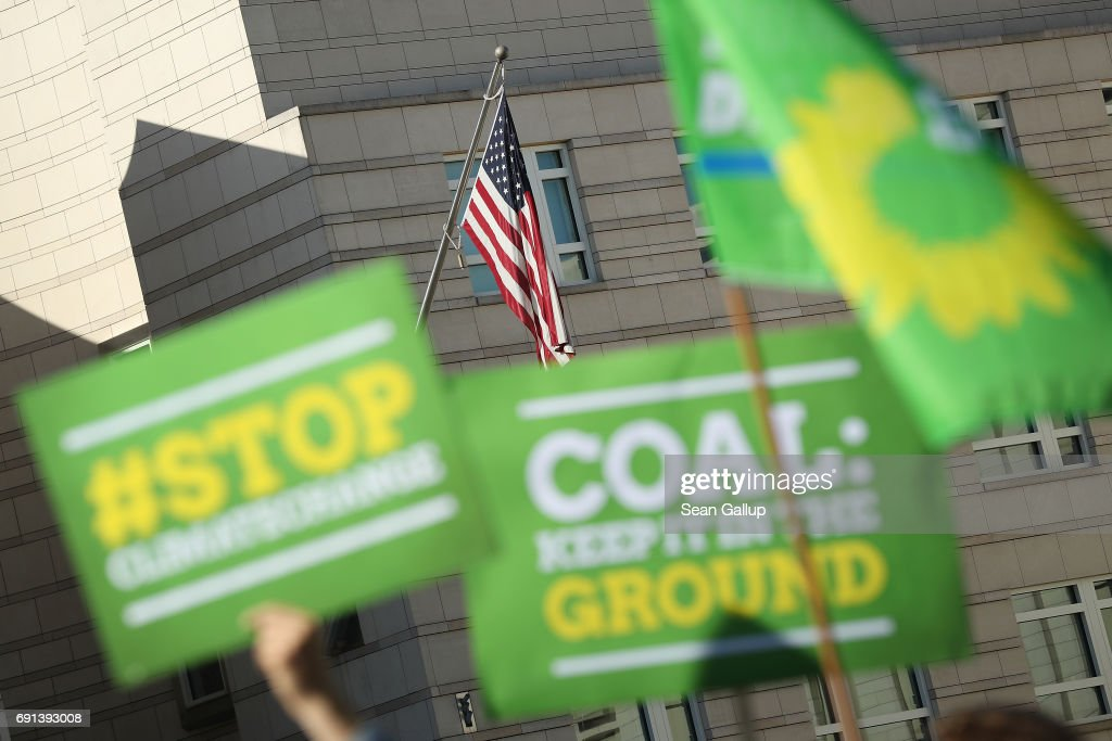 Members of the German Greens Party (Buendnis 90/Die Gruenen) protest outside the U.S. Embassy against the announcement by U.S. President Donald Trump the day before that he will pull the USA out of the Paris Agreement on June 2, 2017 in Berlin, Germany. Politicians and governments across Europe have reacted with dismay and frustration over Trump's decision to pull the world's second biggest emitter of greenhouse gases out of the Paris Agreement. Nearly all the world's acountries signed the agreement in 2015 with the goal of setting a limit to global warming in an effort to counter climate change.