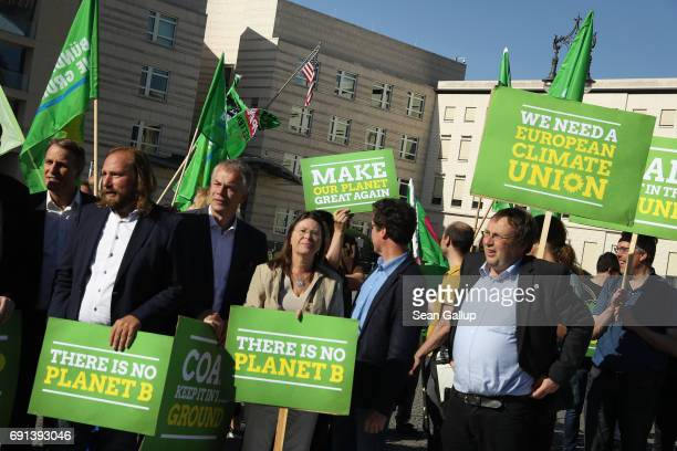 Members of the German Greens Party protest outside the US Embassy against the announcement by US President Donald Trump the day before that he will...