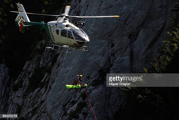 Members of the German Mountain Police and members of alpine rescue outposts simulate the rescue of an injured criminal with an helicopter next to the...