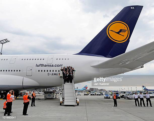Members of the German national football team pose in front of an Airbus A380 of German airline Lufthansa before leaving for the FIFA Football World...