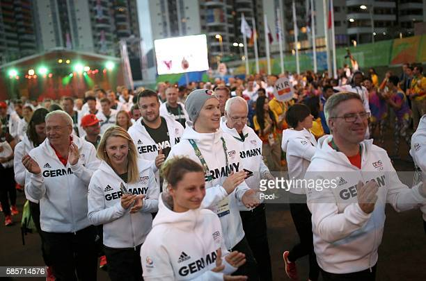 Members of the German Olympic team attend a welcoming ceremony at the Olympic Village August 3 2016 in Rio de Janeiro Brazil