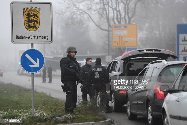 Members of the German police searches all the vehicles driving towards the border between France and Germany at the German bordering city of Kehl on...