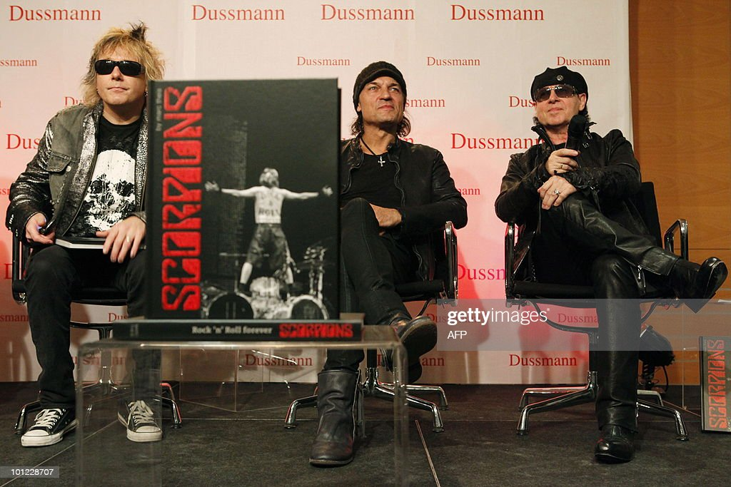 Members of the German rock band Scorpions including (L-R) James Kottak, Klaus Meine and Matthias Jabs address a press conference on May 28, 2010 at the Dussmann bookshop in Berlin during the presentation of a new coffee-table book by photographer Marc Theis. The photographer accompanied the band on their world tour from 2007 to 2009.
