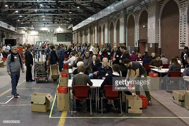Members of the German Social Democrats count votes from other members on December 14 2013 SPD members voted whether they agree that the party should...