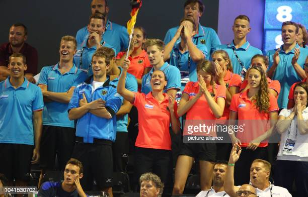 Members of the German Team cheer during the men's 50m Backstroke Finals at the 32nd LEN European Swimming Championships 2014 at the Velodrom in...