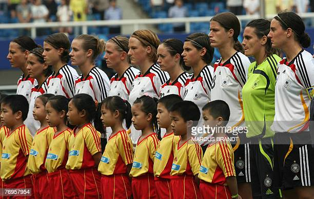 Members of the German team listen to the national anthem before the 2007 FIFA Women's World Cup football against North Korea at the Wuhan Sports...