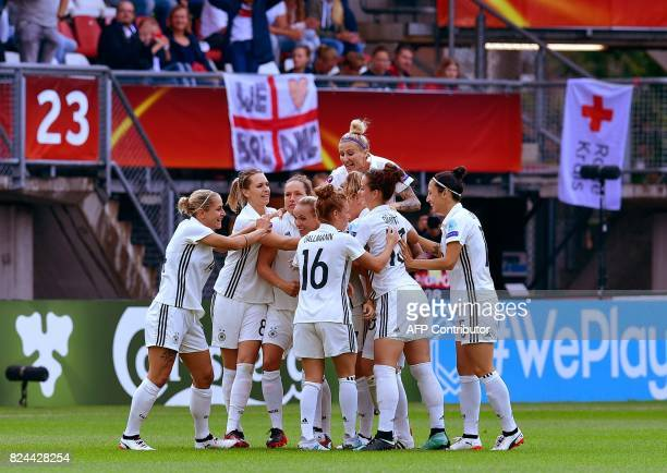 Members of the German team react after scoring during the quarterfinal UEFA Women's Euro 2017 football match between Germany and Denmark at Stadium...