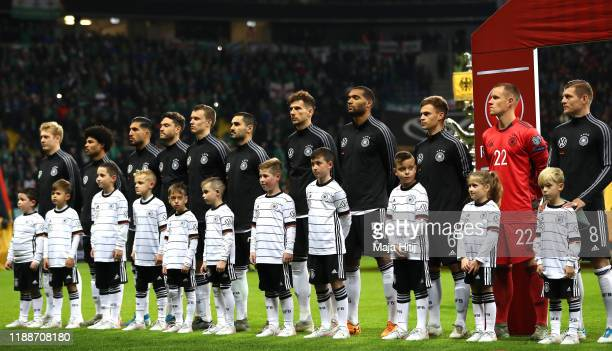 Members of the Germany team line up for the anthem during the UEFA Euro 2020 Qualifier between Germany and Northern Ireland at Commerzbank Arena on...