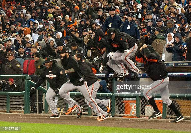 Members of the Giants leave the dugout in celebration as the San Francisco Giants beat the Detroit Tigers 43 in Game 4 of the World Series at...