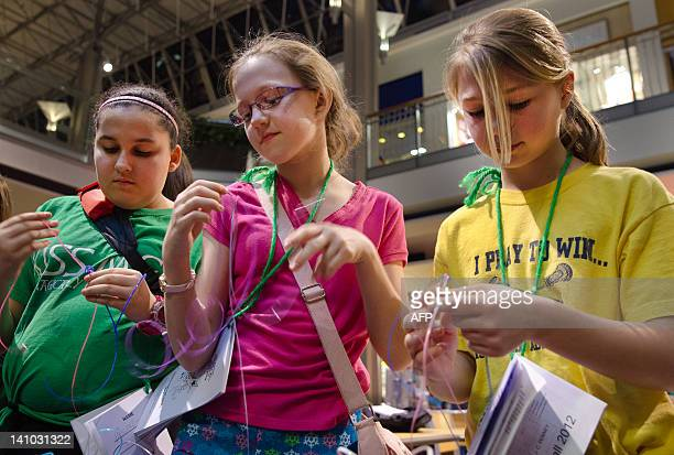 Members of the Girl Scouts of Central Maryland work towards an arts and crafts badge at a shoppingmall sleepover in Columbia Maryland on March 3 2012...