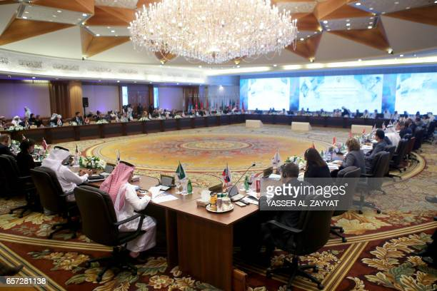 Members of the global coalition against the Islamic State jihadist group gather at a conference in Kuwait City on March 15 for more coordination to...