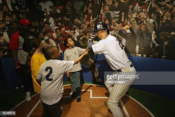 Members of the Gloria Wise Boys And Girls Club attend the launch of a new interactive experience featuring a figure of baseball player Derek Jeter at...