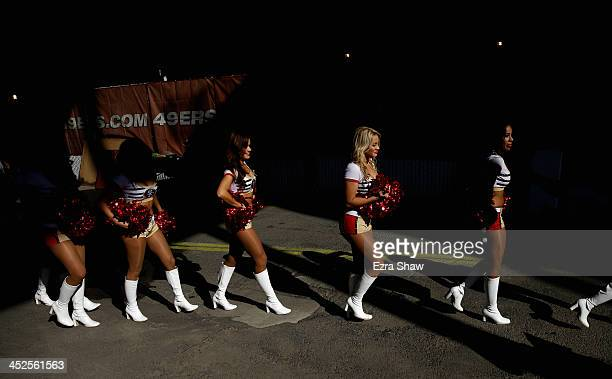Members of the Gold Rush the San Francisco 49ers cheerleaders walk to the field for their game against the Carolina Panthers at Candlestick Park on...