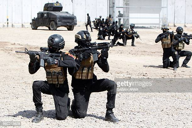 TOPSHOT Members of the 'Golden Division' the special forces of the Iraqi counterterrorism forces take part in a training under the command of...