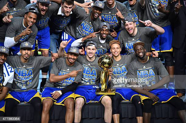 Members of the Golden State Warriors celebrate after winning the NBA Championship against the Cleveland Cavaliers at the Quicken Loans Arena During...