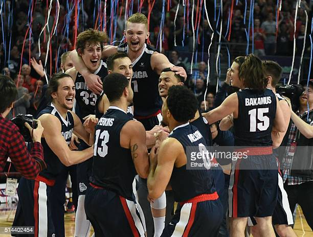 Members of the Gonzaga Bulldogs celebrate on the court after defeating the Saint Mary's Gaels 85-75 to win the championship game of the West Coast...