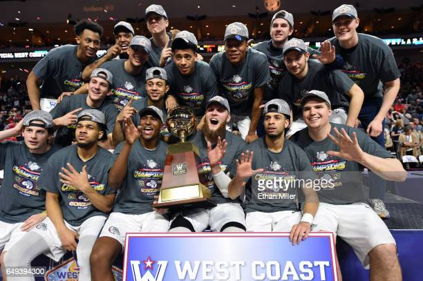 Members of the Gonzaga Bulldogs celebrate with the trophy after defeating the Saint Mary's Gaels 7456 to win the championship game of the West Coast...