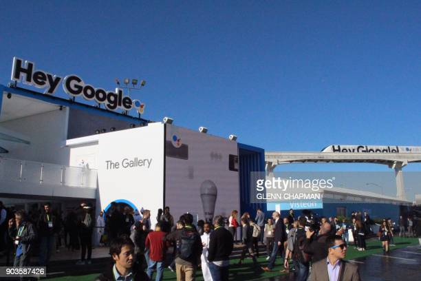 Members of the Google Assistant team wait for a look inside an Amazon Roadshow trailer packed with devices powered by Amazon virtual assistant Alexa...