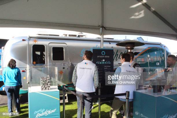 Members of the Google Assistant team wait for a look inside an Amazon's Roadshow trailer packed with devices powered by Amazon virtual assistant...