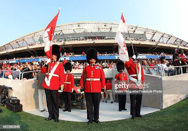 Members of the Governor General's Foot Guards Band look on prior to the franchise home opener of the Ottawa Redblacks against the Toronto Argonauts...