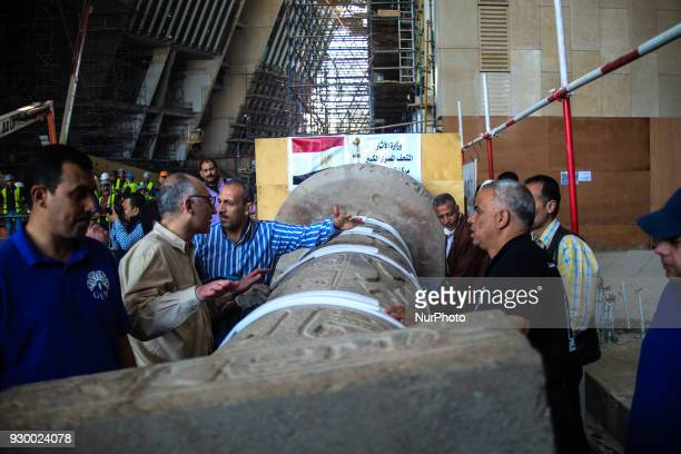 Members of the Grand Egyptian Museum Conservation Centre inspect the column of ancient Egyptian Pharaoh King Merenptah after being transported to its...
