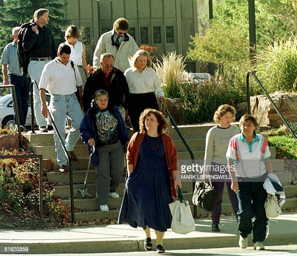 Members of the grand jury investigating the JonBenet Ramsey murder case leave the Boulder Colorado County Justice Center for the last time after a...