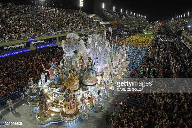 Members of the Grande Rio samba school parade with floats during the first night of Rio's carnival parade at the Sambadrome in Rio de Janeiro Brazil...
