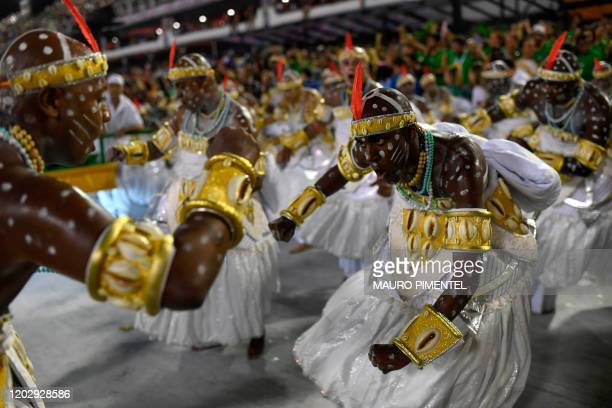 Members of the Grande Rio samba school perform during the first night of Rio's carnival parade at the Sambadrome in Rio de Janeiro Brazil on February...