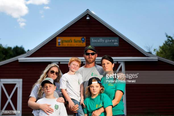 Members of the Grant family pose for a portrait in front of their recently deceased patriarch's farm in Saco A dispute forced the sale of the...