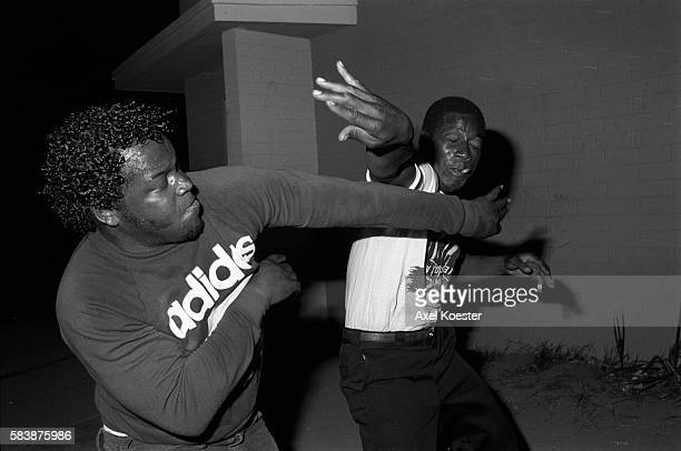 Members of the Grape Street Crips enjoy a friendly fight after partying late in the evening The Grape Street Watts Crips are a mostly African...