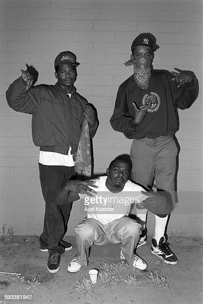 Members of the Grape Street Crips pose throwing their signature 'G' and 'W' hand signs The Grape Street Watts Crips are a mostly African American...
