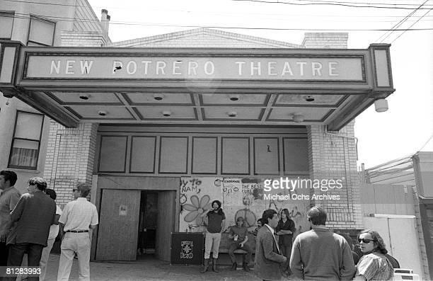 Members of the Grateful Dead hang outside their practice studio the New Potrero Theatre circa 1968 on Potrero Hill in San Francisco California