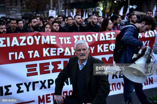 TOPSHOT Members of the Greek Communist labour union demonstrate in central Athens against austerity measures and demanding the increase of minimum...
