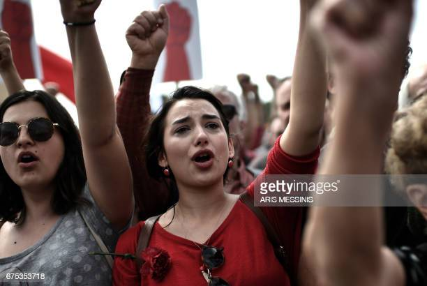 TOPSHOT Members of the Greek communist labour union gesture as theydemonstrate in central Athens during the May Day celebrations on May 1 2017 Greek...