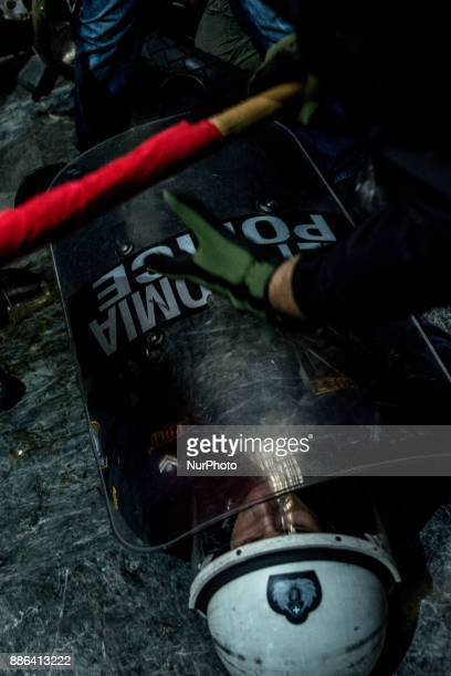 Members of the Greek Communist labour union PAME clash with riot police after storming the Greek labour ministry during a demonstration against the...