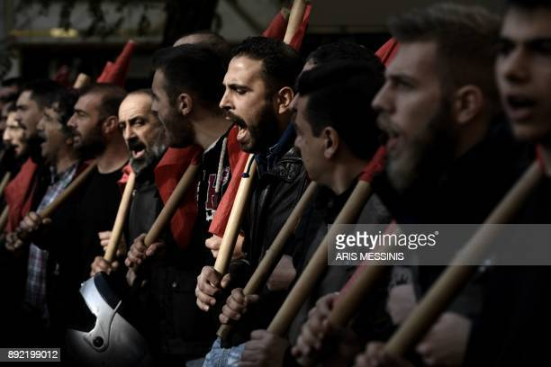Members of the Greek Communist labour union take part in a 24hour general strike in Athens on December 14 2017 The strike has paralysed the civil...