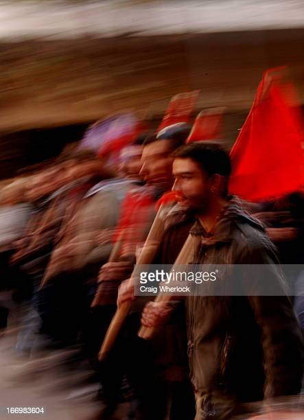 Members of the Greek communist party KKE march in protest in the city of Thessaloniki against the police killing of a 15 year old in Athens.